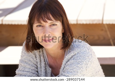 Close up portrait of an attractive older caucasian woman  - stock photo