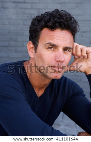 Close up portrait of an attractive older man staring - stock photo