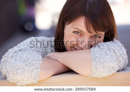 Close up portrait of an attractive older woman smiling outside - stock photo