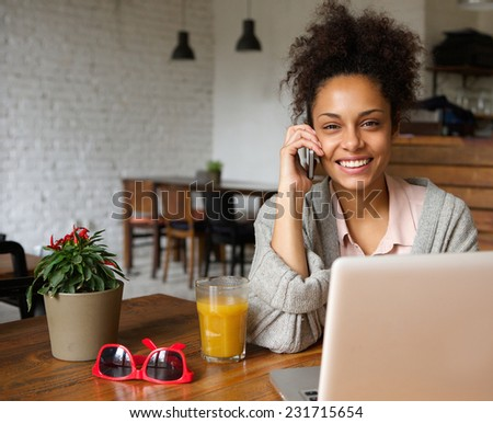 Close up portrait of an attractive you woman talking on phone at home - stock photo
