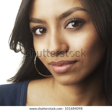 Close up portrait of an attractive young teenage girl isolated against white background. - stock photo