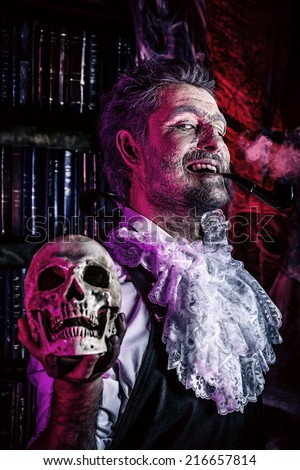 Close-up portrait of an old medieval scientist holding a skull. Alchemist. Halloween. - stock photo