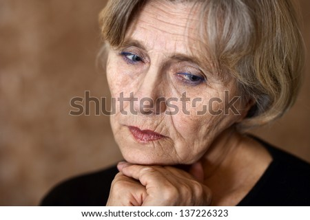 close-up portrait of an older woman over beige background