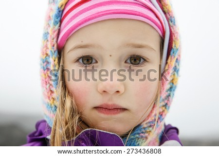 Close-up portrait of an uniquely beautiful little girl with big eyes, thoughtfully gazing at her dad on a trip to Mt. Etna, Sicily, Italy. Active family lifestyle, traveling family concept.  - stock photo