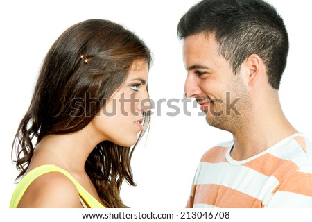 Close up portrait of angry looking girl staring at boyfriend.Isolated on white background. - stock photo