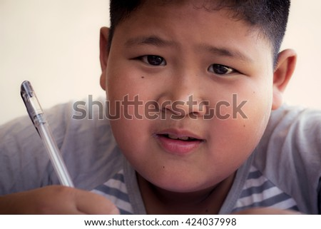 Close up portrait of Asian boy, Study action.