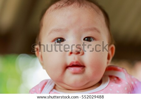 Close up Portrait of Asian cute Infant three months baby girl