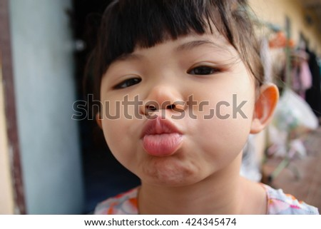 Close up portrait of Asian little girl,Asian little girl in the series photo. - stock photo
