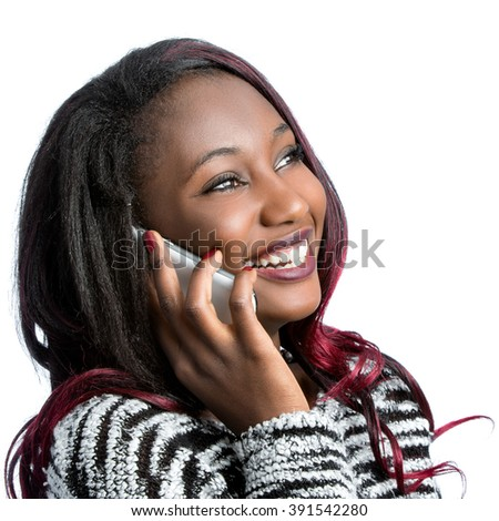 Close up portrait of attractive african teen girl talking on smart phone.Isolated on white background. - stock photo