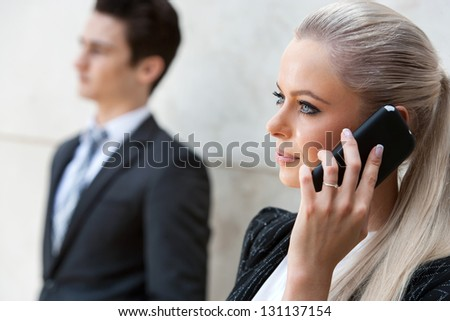Close up portrait of attractive businesswoman talking on smart phone. - stock photo
