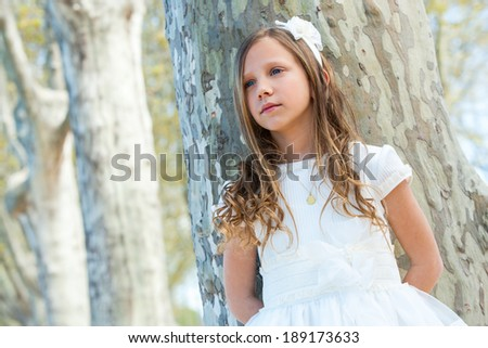 Close up portrait of attractive girl in white outdoors.