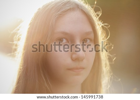 close up portrait of attractive teen girl in sunset, backlighted