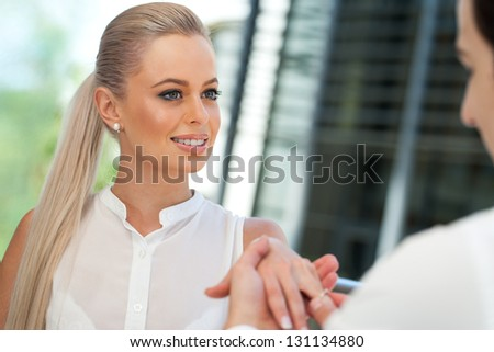 Close up portrait of attractive woman on proposal date. - stock photo