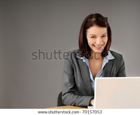 Close-up portrait of attractive young business woman - stock photo