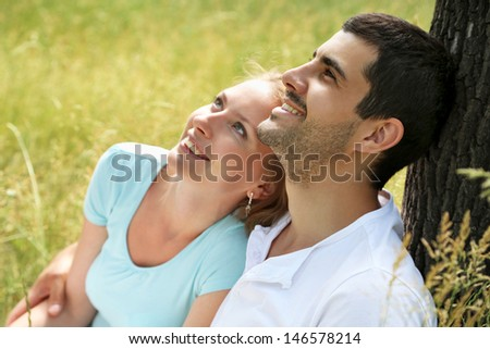Close up portrait of attractive young couple in love outdoors.