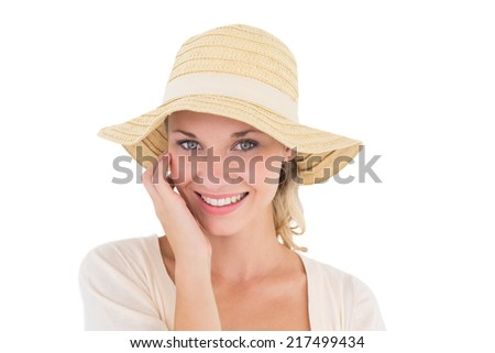 Close up portrait of attractive young woman wearing sun hat over white background - stock photo