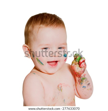 close up portrait of baby playing with bright colors, getting messy hands and face. On white background - stock photo
