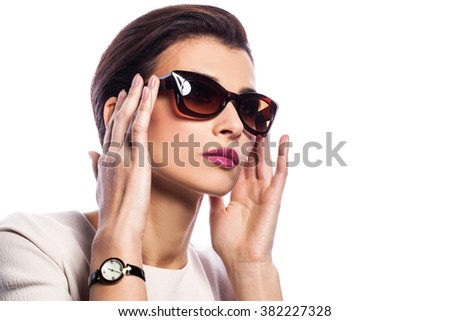 Close-up portrait of beautiful and fashion woman in sunglasses, studio shot. Professional makeup and hairstyle