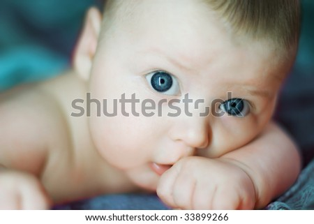 close-up portrait of beautiful baby on blue background - stock photo