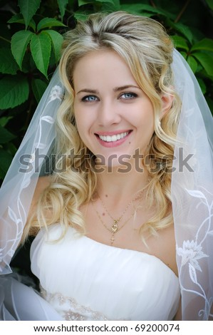 close-up portrait of beautiful blonde bride - stock photo