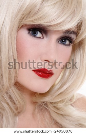 Close-up portrait of beautiful blonde woman with stylish makeup