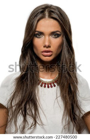 Close-up portrait of beautiful brunette woman with sexy lips and long hair - stock photo
