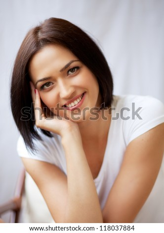 Close-up portrait of beautiful brunette young woman - stock photo