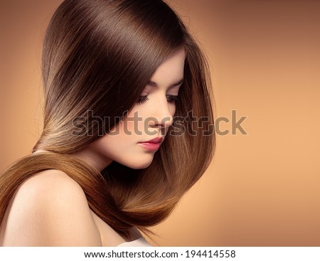 Close-up portrait of beautiful Caucasian teenage girl with healthy straight long hair posing in studio.  - stock photo