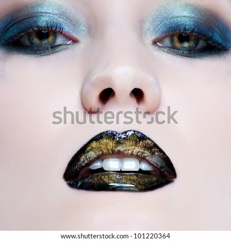 Close-up portrait of beautiful caucasian young woman with pearl glamour make-up and black lips - stock photo