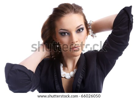 close-up portrait of beautiful dark haired model checking her hair - stock photo