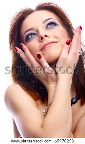 close-up portrait of beautiful dark haired model with hands near her face looking up - stock photo