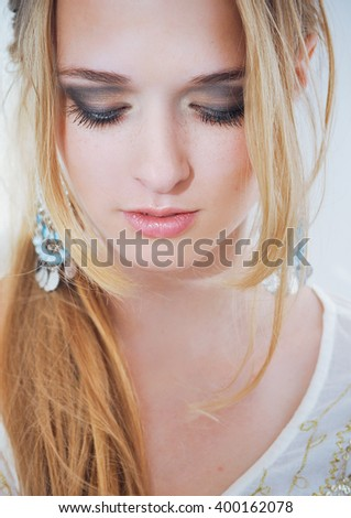 Close up portrait of beautiful daydreaming young woman with blonde hair and bright soft make up. Fresh clear skin, wellness, hairdo - stock photo