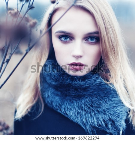 Close-up portrait of beautiful fashion girl in fashionable treatment - stock photo