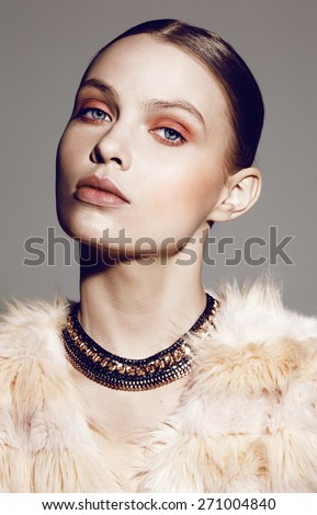 close-up portrait of beautiful fashion model with professional make-up - stock photo