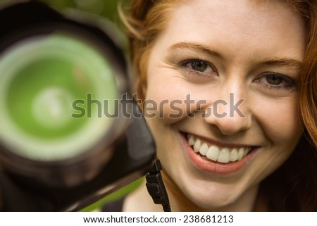 Close up portrait of beautiful female photographer