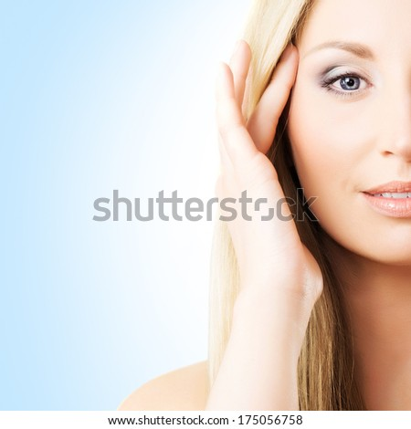Close-up portrait of beautiful, fresh, healthy and sensual girl over blue background - stock photo