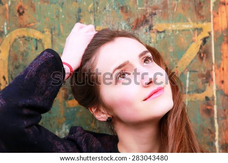Close-up portrait of beautiful girl in the city - stock photo