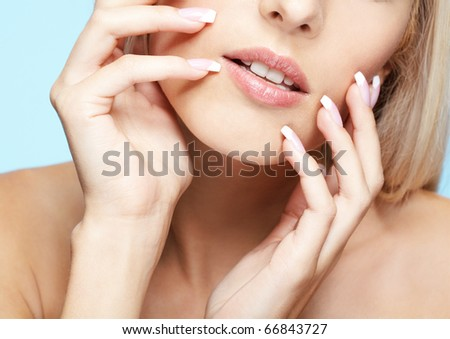 close-up portrait of beautiful girl's lower part of face and manicured fingers