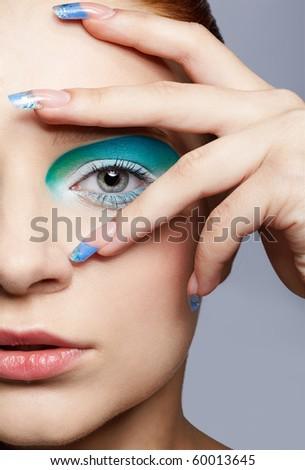 close up portrait of beautiful girl's make up - stock photo
