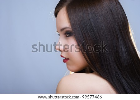 Close-up portrait of beautiful girl with trendy makeup