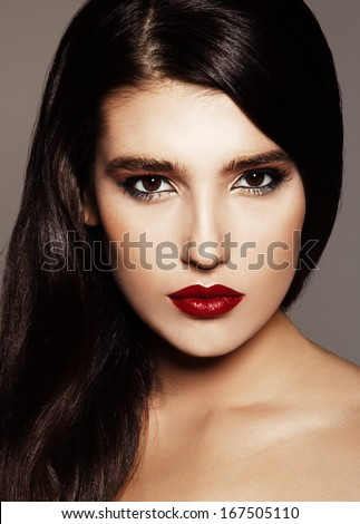 close-up portrait of beautiful model with bright make-up. Red lips  - stock photo
