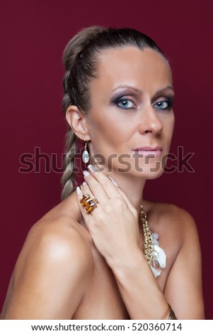 Close-up portrait of beautiful model with make-up and with big yellow crystal ring