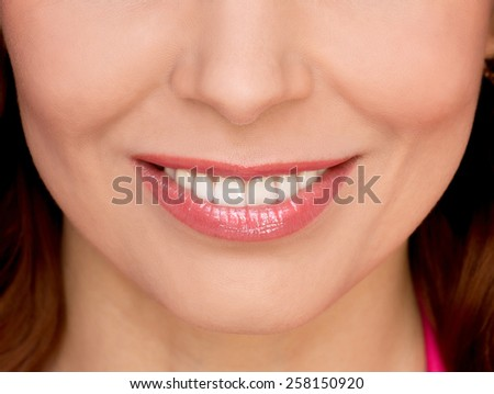 Close up portrait of beautiful smiling woman  - stock photo