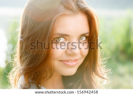 close-up portrait of beautiful teenage girl smiling looking at camera