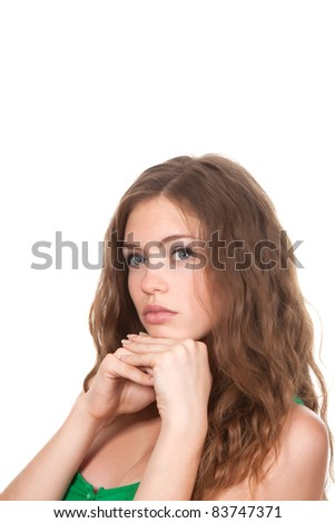 close up portrait of beautiful teenage girl think looking up, brown long hair, isolated over white background - stock photo