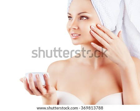Close-up portrait of beautiful woman caring of her face isolated on white background - stock photo