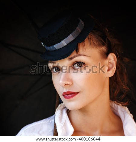 Close-up Portrait of Beautiful Woman Looking to Camera. Vintage Hair Style. Headshot.