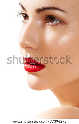 Close-up portrait of beautiful woman's purity face with bright red lips make-up. Cute model with clean shiny skin - stock photo
