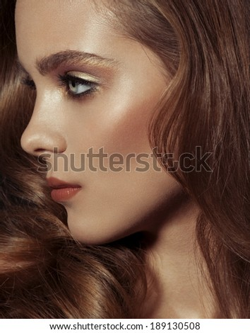 Close up portrait of beautiful woman with bright make-up - stock photo