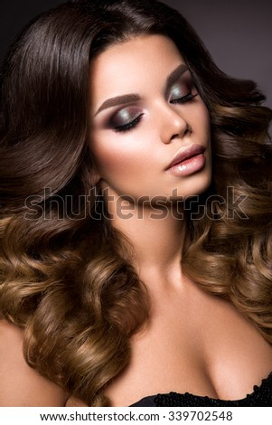 Close-up portrait of beautiful woman with bright make-up and hairstyle. - stock photo